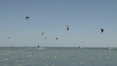 Colorful Kiteboarder Kites In The Sky