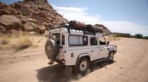 Off Road Safari Vehicle Travels Through Namibian Desert, From Other Vehicle