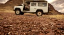Time Lapse, Ants Move In And Out Of Hole With Land Rover Behind