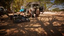 Time Lapse, People Pack Up Camp Into Land Rover As Shadows Move Over