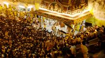 Tracking Shot Of Crowds Taking Offerings To The Hindu Shrine In Batu Caves, Malaysia. The Thaipusam Festival Is The Larges Hindu Festival In Malaysia. Shot Shortly Before Sunrise.