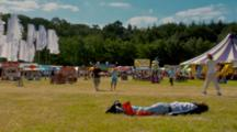 Person Asleep On The Ground At The Glade Festival.