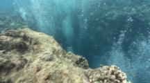 Pov Shot Revealing Entrance To Underwater Cave And Divers Bubbles