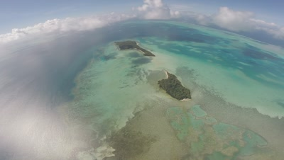 Aerial drone shot of islands in Palau panning to mainland