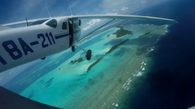 Fixed action cam shot from outside of light aircraft as it flies over tropical islands of Palau