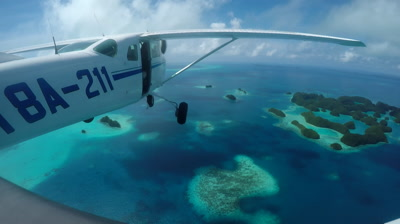 Action cam mounted on light aircraft as it flies over Palau's 70 islands