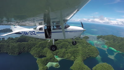 Action cam mounted to wing of light aircraft as it flies over Palau's UNESCO World heritage site