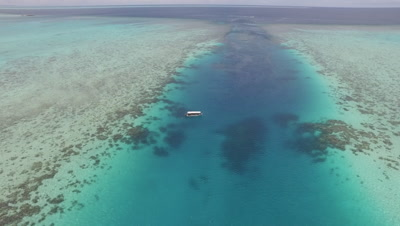 Descending towards tourist dive boat moored in Ulong Channel