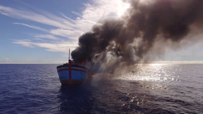 drone aerial shot of illegal fishing boat burning