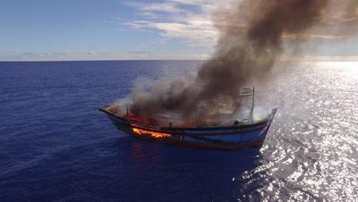 Burning illegal fishing boat