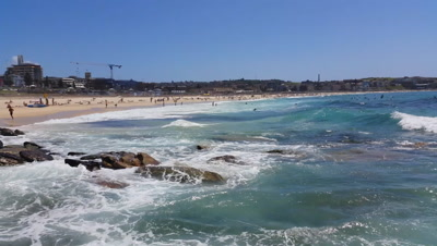 Bondi Beach or Bondi Bay is a popular beach on a hot summers in Sydney, Australia. Bondi is one of Australia's most popular beaches.