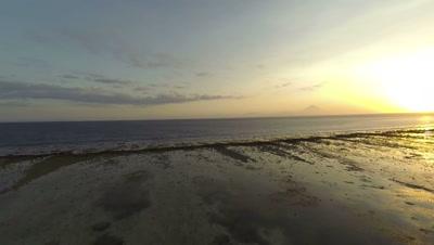 Sunset in Gili Trawangan, Lombok, with view of Agung volcano, aerial shot