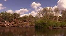 Trees And Rock Formations At Edge Of Tranquil Kimberley Water Pool