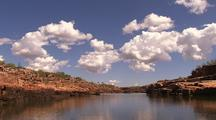 Travelling Up Coastal River With Red Rock Banks, Kimberley