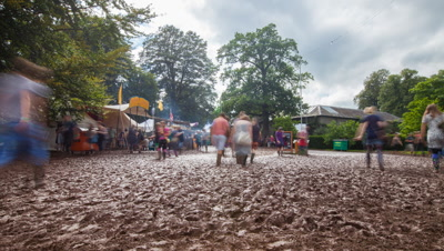 People walking through mud at Green Man festival 2012