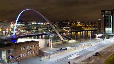 The Millennium Bridge on the River Tyne opening and closing with a boat passing through.