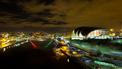 View of the Newcastle/Gateshead quayside from the Tyne Bridge. In view is the river, the Sage music hall, The Baltic and the Millennium Bridge.