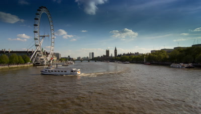 Shot looking down the river Thames with the London Eye, Big Ben and Houses of Parliament.