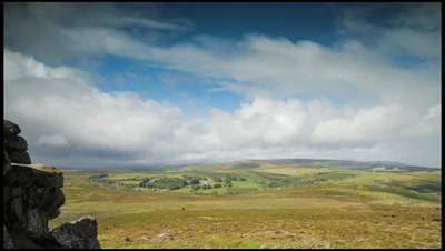 Looking west from Haytor on Dartmoor, UK. Slow pan right to left as shower clouds sweep overhead and ends with rain drops on lens.