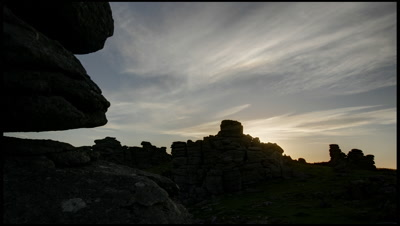 Pre dawn then sun rising over the rocky outcrop of Hound Tor on Dartmoor in Devon, UK.