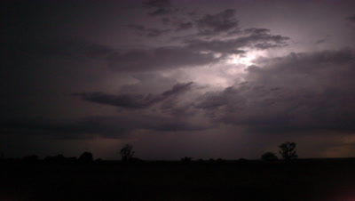 Medium wide angle dramatic electrical storm over dry savannah Africa