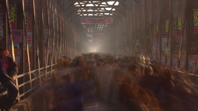 Medium wide angle Looking through covered bridge, over heads of crowds of people streaming across to and from camera, Sonpur, Bihar, India