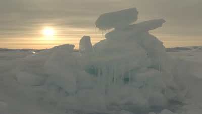 Close up sea ice with cloudy arctic sun behind at Grise Fjord