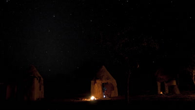Medium wide angle Himba village at night with big starry sky