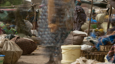 Mid shot busy people bustling around Djenne market to match with RK_00451