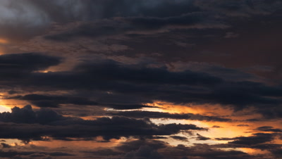 Mid shot soft evening sky of mercury grey with slow blue cloud drifting through, turns to burnt orange then blacks out