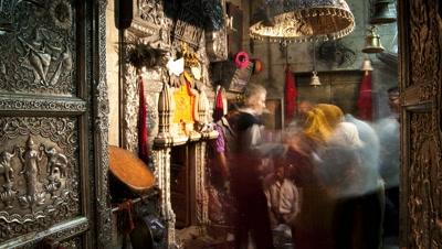 Medium wide angle devotees coming to make offerings at Karni Mata Rat Temple