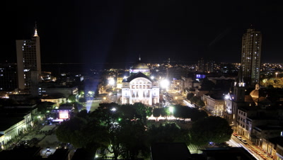 Wide angle top shot floodlit Manaus Opera House with outside stage performance at night