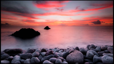 Sunset over the Caribbean with pebble foreground, Champaigne Beach