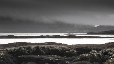 Rain showers sweep over Scottish Loch