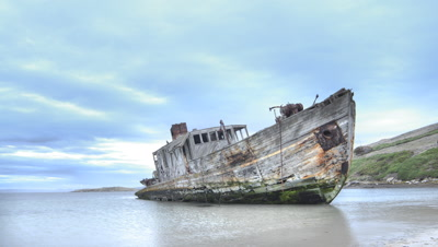 Clouds over beached ship on New Island, Falklands