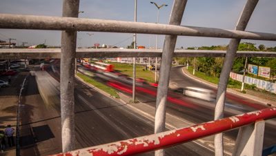 Tracking high shot of traffic heading towards downtown Manaus, Brazil