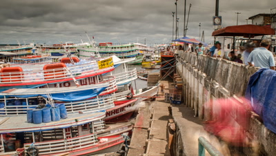 Loading and unloading boats in the Rio Negro Port of Manaus