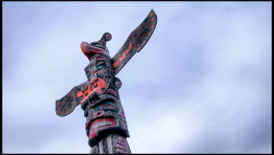 First Nations Totem Pole with Clouds in Alert Bay