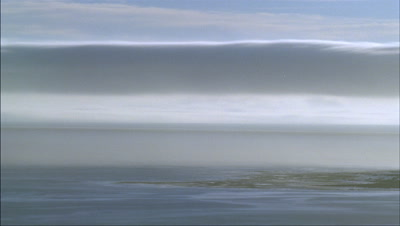 Mid shot fog rolling over surface of sea - matches RK10134