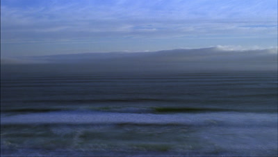 Medium wide angle fog rolling over surface of sea with waves rippling to shore - matches RK10133