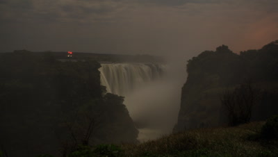 Medium wide angle looking through gorge to face of Falls by moonlight with rising spray