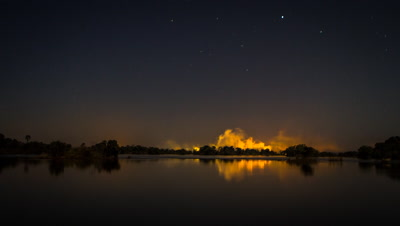 Reflection of Victoria Falls spray, Zambezi River, Night-sky
