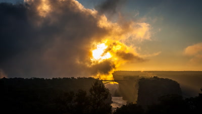 Sunrise through spray, Victoria Falls Bridge