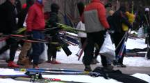 American Birkebeiner, Skis Lying In Snow, Skiers Passing On Way To Start Line
