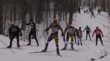 American Birkebeiner, Skiers Coming Up Hill In Woods