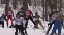 American Birkebeiner, Large Group Of Skiers Topping Rise In Woods