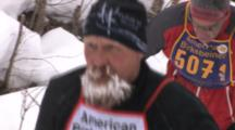 American Birkebeiner, Skiers Coming Through Woods, Zoom To Skier With Frosty Beard