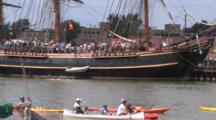 Canoes, Kayaks, Passing Anchored Hms Bounty, Tall Masted Sailing Ship In Lake Michigan Harbor