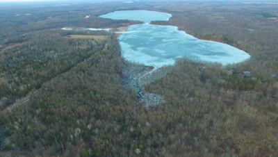 Ice-locked Lake in Early Spring, Deciduous Setting