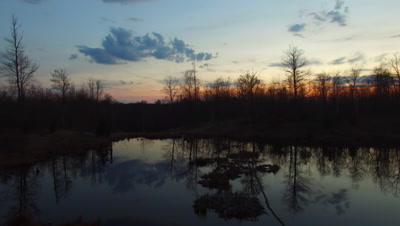 Sunset on Beaver Pond, Travel Across, Reflection of Clouds in Pond